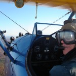 Passenger in Stearman biplane enjoying the ride